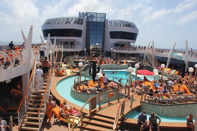 Swimming pool aboard the MSC Divina with sunbathers